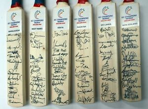 Cricket 2004 mini world cup team signed bats