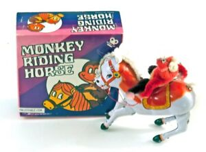 Vintage colorful circus monkey riding a horse, made in China