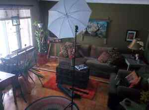 Tripod with umbrella mount for flash photography