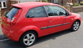 Red Ford Fiesta/ 2006/ 56 Plate/ 1242cc/ Freedom/ 3dr/ Hatchback/ Petrol/ Manual/ 83,00 Miles