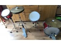 Child's four piece drum kit - including stool and drum sticks.