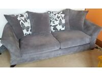 DFS charcoal grey, 3 seater sofa and swivel 'cuddler' chair.