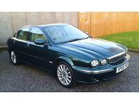 Jaguar x type AWD 2.5 petrol auto in british racing green