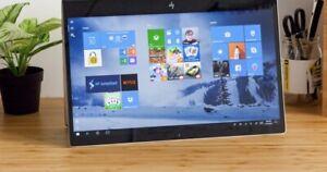 HP Envy x360 Silver laptop.