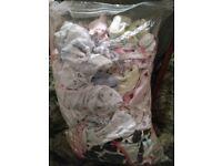 Big bag full of newborn baby clothes