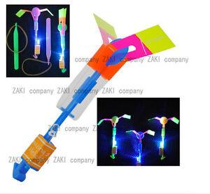 50Px-LED-Light-Up-Amazing-Flying-Sling-Arrow-Helicopter-Rocket-Parachute-Frisbee