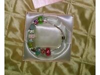 PANDORA STYLE BRACLET SILVER WITH 9 CHARMS