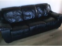 modern 3 and 2 seater black leather sofas in good condition
