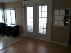 One spacious room is available for rent in a house in Gatineau