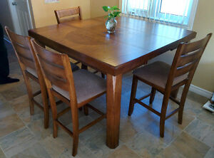 Brand new hardwood dining table (4-6 people) w/ 4 chairs
