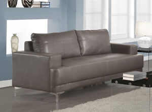 SOFA IN GREY BONDED LEATHER WITH CHROME FEET FLOOR MODEL 499$