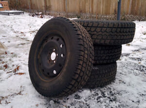 4x Motomaster Total Terrain 215/70R16 W/T winter tires  and rims