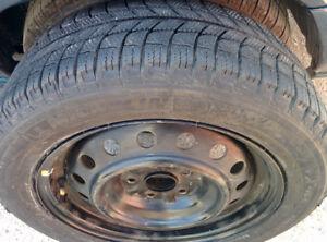 4 x 205/55R16 Michelin winter tires on Toyota rims, 90% tread