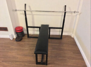 Olympic weight Bench with Standard bar for only $100.