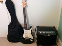 Squier Fender electric guitar with amp, bag, cords and picks!!