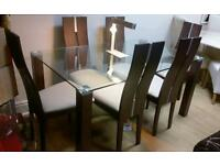 Beautiful glass and darkwood dining table and chairs