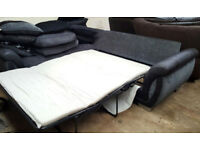 DFS Corner Sofa Bed-Grey/Black. Local delivery available