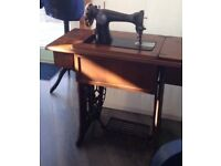 Vintage Singer sewing machine as object with table