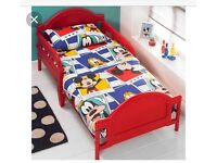 Red Mickey Mouse Toddler bed.