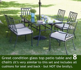 Grab a bargain - Glass patio table and 8 chairs and cushions.