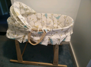 Moses bassinet with jolly jumper rocking stand