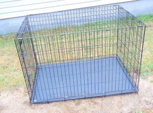 One left extra large dog kennel 48``L x 30`` W x 33`` H $70.00