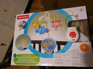 Infant crib mobile with remote