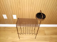 Vintage metal magazine rack with black ceramic ashtray.