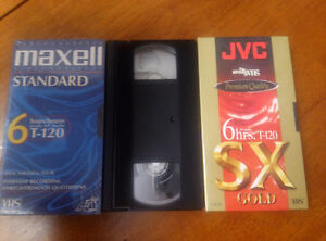 Three blank (unopened) VHS tapes