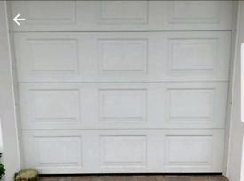 Electric motorised garage door white panels