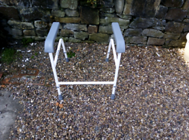 Mobility aid toilet frame