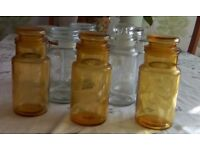 Eight different sized storage /kilner jars all seal completely. Three are amber coloured.