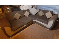 Lovely chunky beige and brown fabric corner sofa with contrasting cushions very comfy