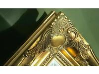 Large glass ornate mirror with bevelled edges