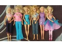 6 Barbie Dolls