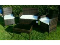 New Rattan garden furniture set 2 single chairs sofa chair and coffee table.