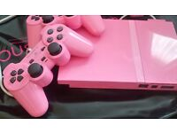 Pink playstation slim with 2 controllers
