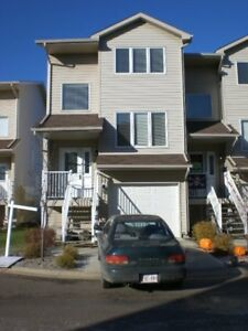 3 bedroom 2 and 2 half bath with garage and driveway end unit