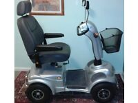 FOUR WHEEL MOBILITY SCOOTER. FOREVER ACTIVE. ROAD LEGAL. 30 MILES ON ONE CHARGE. EXCELLENT CONDITION