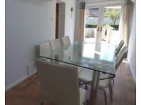 Glass dinning table with 6 cream chairs
