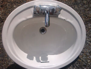 Oval bathroom sink,with taps.Small chip in sink $10.00