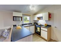 static caravan center lounge for sale in Newquay Cornwall heated swimming pools close to beaches.