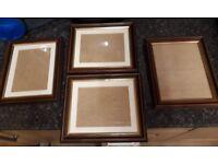 Four hardwood picture frames.