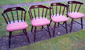 ARCHED BACKED SPINDLED 4No. WOODEN CHAIRS WITH CHEQUERED SEAT PAD UPHOLSTERY.