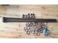 Large thick wooden curtain pole with wooden pole rings, etc. Max length 126 inches