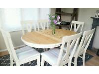 Solid pine extending table and 6 oak chairs