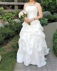 Wedding gown - fits sizes 2-10 worn only once to take photos