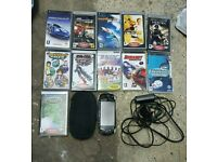 PSP (SLIM) WITH GAMES AND CASE