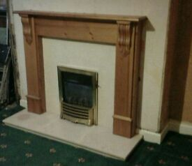 Electric fire, Granite surround and wooden mantle peice