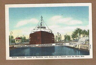 (Saute Ste Marie,MI Michigan,modern freighter loaded in MacArthur Lock,Guard Rail)